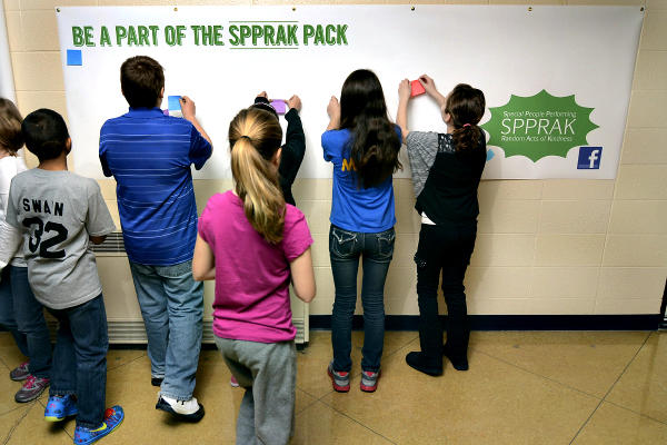 Students at Dixie Bee Elementary School in Terre Haute, Ind., post positive messages about fellow classmates and the school's staff. SPPRAK, a local not-for-profit, unveiled a new program this week that literally 'notes' random acts of kindness by students, teachers, and staff.  <P>Joseph C. Garza/The Tribune-Star/AP