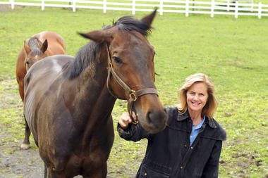Erin Hurley, who runs the nonprofit South Jersey Thoroughbred Rescue and Adoption, Inc., stands with one of her charges in a paddock at Stillpond Farm in Moorestown, N.J. Racehorses have notoriously short careers, but can be retrained.