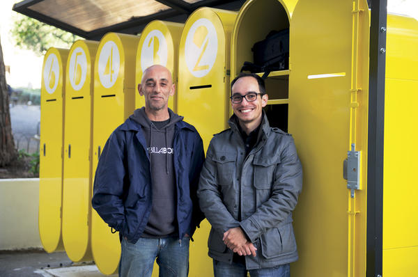 Duarte Paiva (r.) stands with Jorge Toledo in front of the lockers he designed for homeless people in Lisbon to store their treasured possessions.