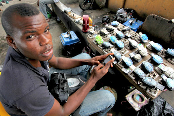 Jamil Idriss charges 50 naira ($0.33) to recharge phone batteries by plugging them into a diesel generator in Lagos, Nigeria. Most of Nigeria is hampered by constant power outages, meaning his customers can't charge their own phones. Multifunction diesel generators are helping generate electricity and do other kinds of work all over Africa.  <P>Akintunde Akinleye/Reuters/File