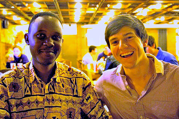 Teach Twice East Africa regional director Paul Kabanda (left) and co-founder Trevor Burbank: Kabanda found the story, writer, and illustrator in Uganda for the social venture's first book.  <P>Kenneth Khoo