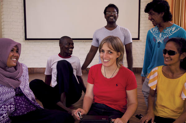 Sabriye Tenberken (c. with red shirt) is surrounded by participants in her kanthari institute course for aspiring social innovators.  <P>Charukesi Ramadurai