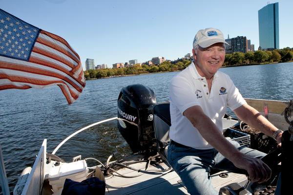 Tom McNichol cleans up trash on the Charles River in Boston. The Charles River Clean Up Boat has been operating for 10 years.  <P>Melanie Stetson Freeman/Staff
