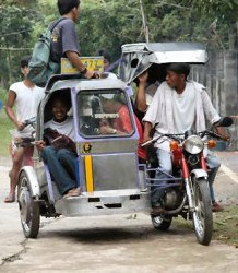 <a href=http://www.envirofit.org/>A tricycle taxi in Vigan </a>