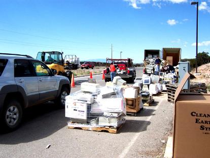 An <a href=http://www.nmrecycle.org/images/Santa%20Fe%20E-Waste%20Event%202004A.jpg>e-waste recycling drive</a> in Santa Fe, New Mexico