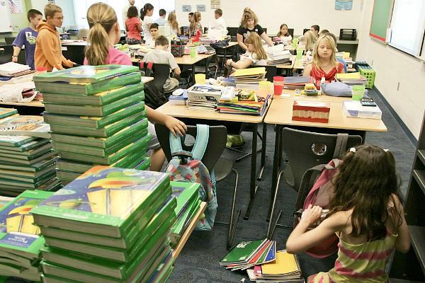 Student gather on the first day of school at Wyandotte Elementary School near Lafayette, Ind., in 2011. Wyandotte is one of many US schools that have made cutting energy use a priority. In Richardsville, Ky., one elementary school is more than 'net zero': It sells about $2,000 in electricity each month back to the local utility. <P> Michael Heinz/The Journal & Courier/AP/File