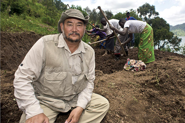 Filmmaker John Dennis Liu, here in Rwanda, has documented ecological projects in diverse locations such as Haiti, Jordan, and China.  <P>Courtesy of Environmental Education Media Project