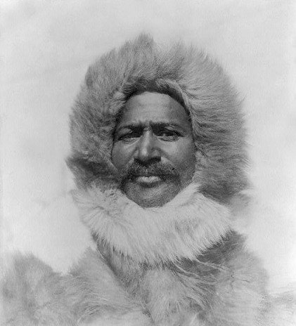 "<a href= https://www.americaslibrary.gov/jb/reform/jb_reform_peary_2_e.html>""Matthew Alexander Henson, head-and-shoulders portrait, facing front, wearing fur hat and fur coat.""</a> C 1910. Prints and Photographs Division, Library of Congress."