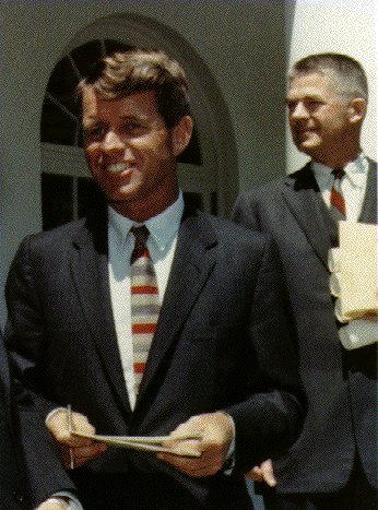 Attorney General of the United States Robert F. Kennedy, Solicitor General Archibald Cox in background, May 7, 1963. White House, Stoughton.<br>Photo courtesy of John F. Kennedy Library and Museum