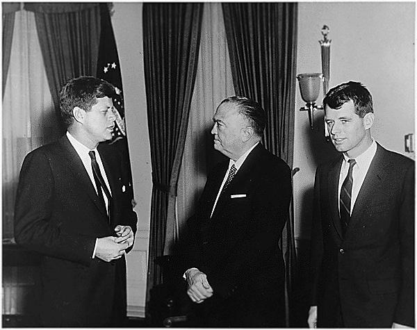Visit of Attorney General and Director of FBI. President Kennedy, J.Edgar Hoover, Robert F. Kennedy. White House, Oval Office. 2/23/1961<br>Photo courtesy of John F. Kennedy Library and Museum