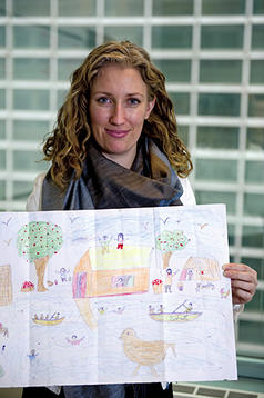 Pernille Ironside, a UNICEF child protection specialist, holds a child's depiction of Pakistan's flood that was created in UNICEF's Child Friendly Spaces program.  Ann Hermes/Staff