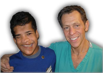 Yordano, an 11-year-old boy from rural Panama born with a cranial deformity, and <a href=http://www.mmissions.org/top/first_child.html>MMC's first patient</a>, along with his doctor.