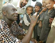 Otunnu and children from Afghanistan