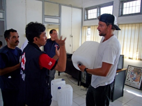 Jon Rose, right, and Alfri, a local Red Cross worker in the city of Padang, discuss how to make the plastic gas canisters work as water filters.<br>Photo courtesy of Jon Rose