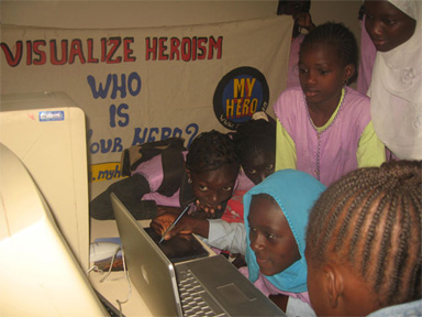 Cheikh Seck's students using a Wacom Pad to create digital art for MY HERO