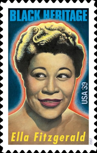 <a href=https://z.about.com/d/stamps/1/7/3/-/-/-/EFitzgerald300dpi.jpg>Ella, honored by the US Postal Service</a>