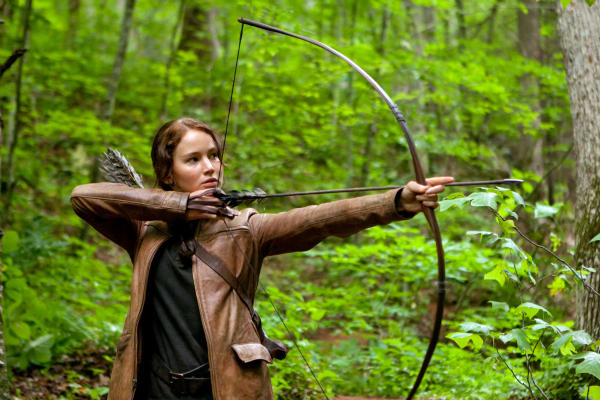 Jennifer Lawrence portrays Katniss Everdeen in a scene from the movie 'The Hunger Games,' opening March 23, 2012. The movie has spawned fan-based efforts online to fight hunger in the real world.  <P>AP Photo/Lionsgate, Murray Close