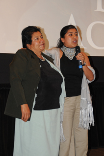 Erica Fernandez (right) gives her acceptance speech alongside her mother, after she is awarded the Eldon Activist Award