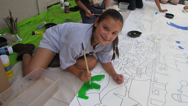 Laguna Beach Boys and Girls Club student poses for a picture during the mural painting <P>(Photo courtesy of Robin Wethe Altman)
