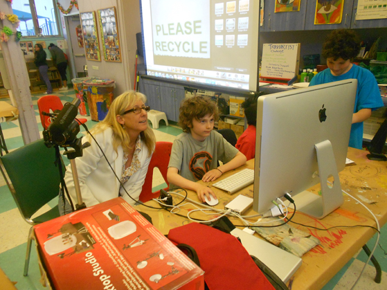 Media Arts Director Wendy Milette assists students during the ECO-Heroism program at the Laguna Beach Boys and Girls Club