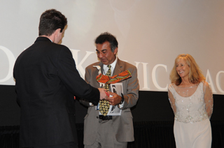 Azim Khamisa, receives his award from David Kelly, curator of the MY HERO Film Festival, alongside the Director of the Film Festival, Wendy Millette