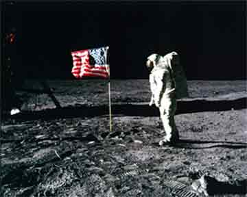 Astronaut Buzz Aldrin Salutes US Flag<br>https://history.nasa.gov/ap11-35ann/kippsphotos/5875.jpg