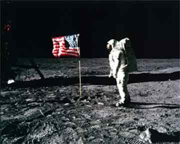 Astronaut Buzz Aldrin Salutes US Flag<br>http://history.nasa.gov/ap11-35ann/kippsphotos/5875.jpg