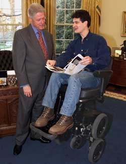 President Bill Clinton and Dean Kamen on his iBOT mobility system in the White House.