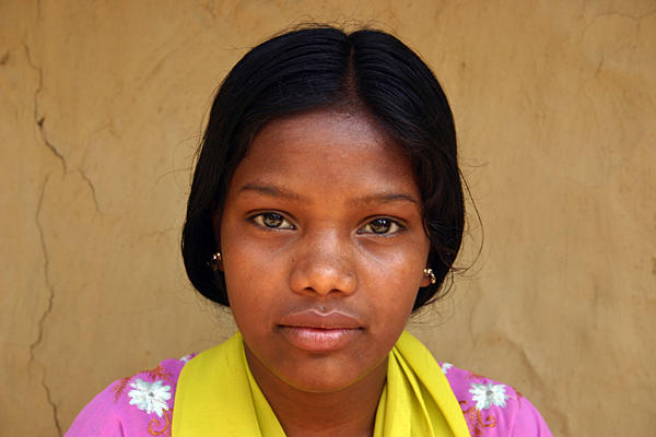 Rekha Kalindi, a 12-year-old girl living in Bararola, India, refused to get married when her parents tried to arrange one and insisted on staying in school.  <P>Ben Arnoldy