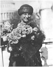 Mrs. Huck received flowers from Alice  Robertson, the 2nd woman elected to congress, on the day of her swearing in. (Image courtesy of Library of Congress)