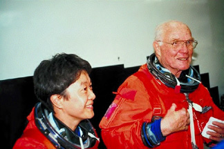 Chiaki with John Glenn.  NASDA photo from Spaceboy.Nasda  Photo library