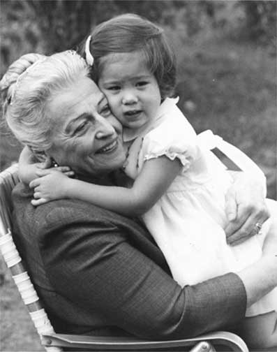 <center>Pearl S. Buck with a Welcome House child in the 1960s.  <br>Photo courtesy of: http://www.english.upenn.edu/Projects/Buck/tour.html</center>