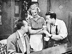 "Chet Roble, Beverly Younger, and Terkel on the television comedy, ""Studs' Place."""