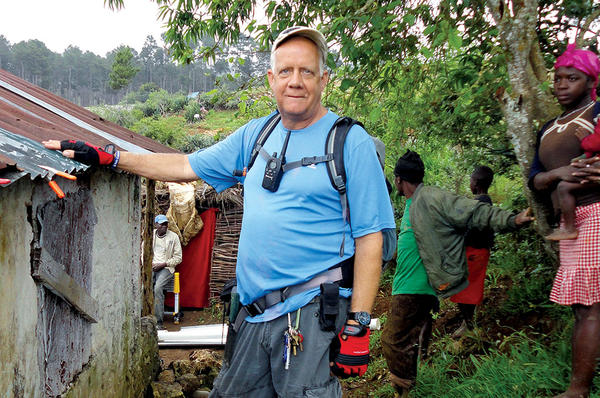 Bob Keesee combines simple materials such as PVC pipes, tubing, and brackets to build rain-catching systems that provide clean water to thousands of people living in Haiti. <P>Judith Ritter