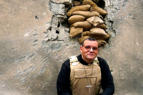 The Rev. Canon Andrew White, vicar of the only Anglican church in Baghdad, is seen wearing a bulletproof vest. <P>Courtesy of FRRME