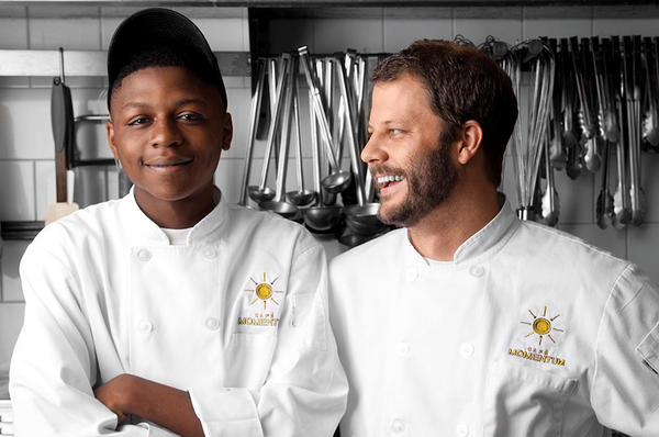 Chad Houser (r.) founded Cafe Momentum to teach former juvenile offenders, such as intern Malik Runnels (l.), life skills. They'll work at his nonprofit restaurant in Dallas. <P>Courtesy of Santon J. Stephens/Cafe Momentum