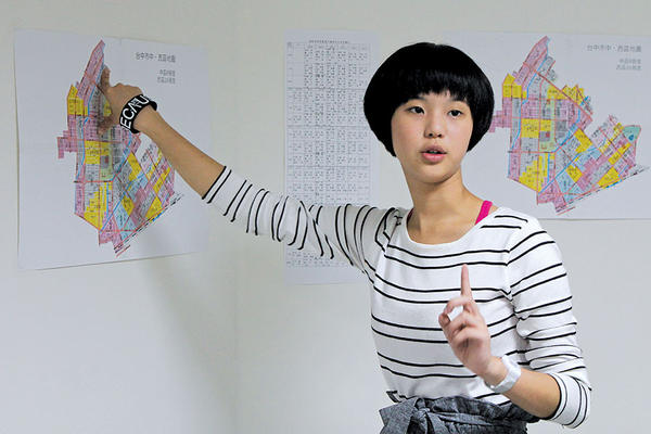 THE TARGET: Chen Hui-jie points to a map of a city council district in Taichung, Taiwan. The 17-year-old is campaign manager for a candidate there. <P>Julian Baum