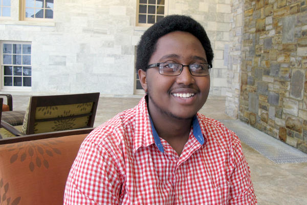 Middlebury College junior Armel Nibasumba founded a camp in his native country of Burundi designed to break down ethnic barriers between Hutus and Tutsis. <P>Wilson Ring/AP