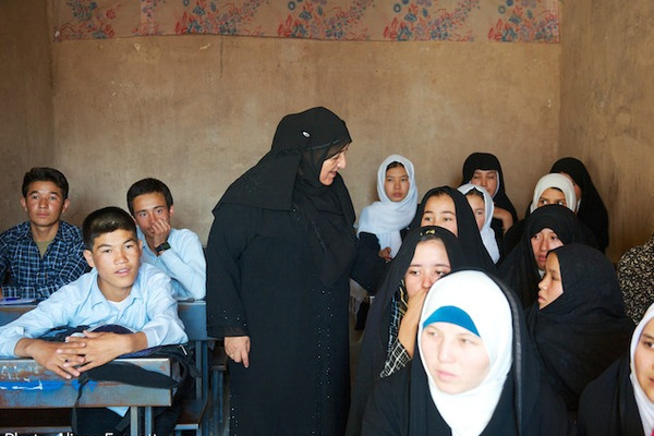 Sakena Yacoobi founded the Afghan Institute of Learning to secretly teach girls. But later she found boys wanted to be educated too. 'Educated, wise women help their families financially and raise educated, wise children. Educated, wise men do not abuse women or children and recognize the worth and value of women and children,' she says. <P>Courtesy of Alissa Everett