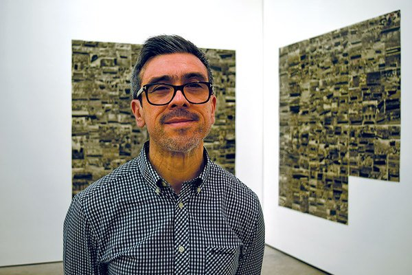 Raúl Cárdenas Osuna, founder of Torolab, stands in a gallery in Mexico City that is exhibiting some of the collective's work.