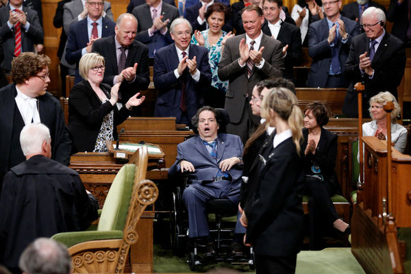Liberal MP Mauril Bélanger receives a standing ovation yesterday after the approval of his bill to make the national anthem gender neutral - Chris Wattie/Reuters