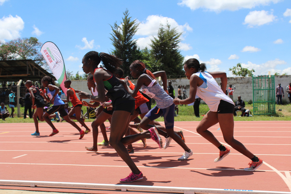 Angelina Nadai of South Sudan (center, in light blue top) competes in a 1500 meter race at a recent meet in Eldoret, Kenya, where her competitors were among the country's most elite middle distance runners.