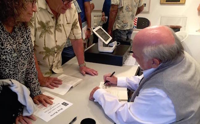 Ron Kovic signs books for an appreciative crowd at Santa Monica reading.