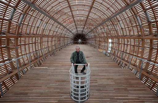 Leos Valka, a co-creator, poses for a photo inside a giant object resembling a zeppelin airship at an arts center in Prague, Czech Republic, Monday, Sept. 19, 2016. The 42-meter long and 10-meter wide ship is planned to seat some 120 people on its cascade steps. It will be used for authors' reading and debates about literature to complement exhibitions at the DOX Centre for Contemporary Art, one of the most innovative and challenging galleries in the Czech capital. (AP Photo/Petr David Josek)