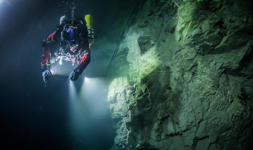 In this underwater photo taken Aug. 21, 2015, in the flooded Hranicka Abyss, Czech Republic, Polish explorer Krzysztof Starnawski is seen examining the limestone crevasse and preparing for a 2016 expedition to measure it depths. On Sept. 27, 2016 Starnawski and his Polish-Czech team discovered that the cave goes 404 meters (1,325 feet) down, making it the world's deepest known flooded abyss. (Krzysztof Starnawski of the Krzysztof Starnawski EXPEDITION via AP)