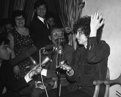 In this May 22, 1966, file photo, Bob Dylan gestures during a news conference in Paris, France. Dylan won the 2016 Nobel Prize in literature on Thursday, Oct. 13, 2016, a stunning announcement that for the first time bestowed the prestigious award on a musician for