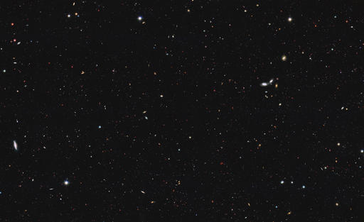 This image made available by NASA, ESA/Hubble on Thursday, Oct. 13, 2016 shows a portion of the southern field of the Great Observatories Origins Deep Survey to recalculate the total number of galaxies in the observable universe. In a report published on Thursday, an international team of astronomers, led by Christopher Conselice, Professor of Astrophysics at the University of Nottingham, have found that the universe contains at least two trillion galaxies, twenty times more than previously thought. (NASA, ESA/Hubble via AP)