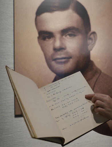 In this March 19, 2015 file photo, a page from the notebook of Alan Turing, the World War II code-breaking genius, is displayed in front of his portrait at an auction preview in Hong Kong. Turing, who was convicted of indecency in 1952 for being gay and later killed himself, was awarded a posthumous royal pardon in 2013. Britain's government announced Thursday, Oct. 20, 2016, that it will posthumously pardon thousands of gay and bisexual men convicted under the long-repealed anti-gay laws. (AP Photo/Kin Cheung, File)