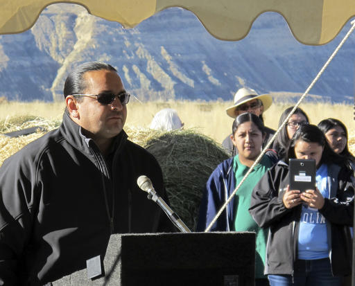 Jason Baldes, coordinator of the buffalo restoration effort for the Eastern Shoshone Tribe, addresses a crowd south of Pilot Butte, Wyo., on the Wind River Indian Reservation Thursday, Nov. 3, 2016. The Eastern Shoshone Tribe released 10 buffalo, marking the first time in more than a century that the animals have roamed the area. (AP Photo/Ben Neary)