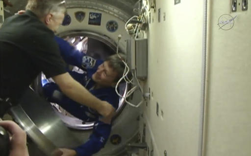 In this image made from video provided by NASA, astronaut Peggy Whitson boards the International Space Station on Saturday, Nov. 19, 2016. This is the third space station mission for Whitson, who at 56 is older than each of her crewmates. (NASA via AP)